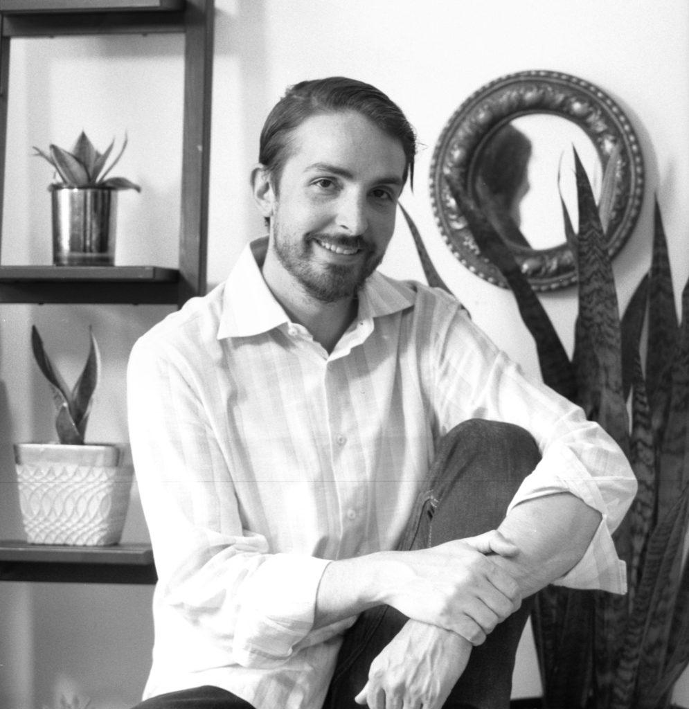 Monochrome portrait of man smiling